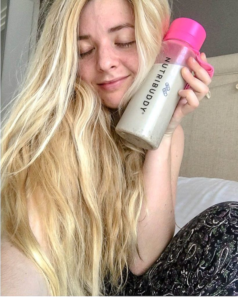 Blonde girl with IBS friendly meal replacement shake